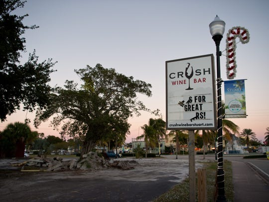 Crush Wine Bar was one of three businesses that were on the Triangle property before the city leased the land to a developer building a 49-unit apartment building.