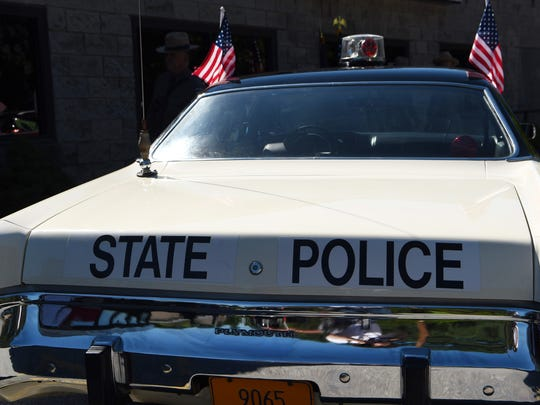 An old state police cruiser parked at Roosevelt Cinemas before the 2017 July 4th parade in Hyde Park.