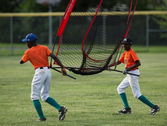 Izaeias Smith, left, and Xavier Helm put up the hitting
