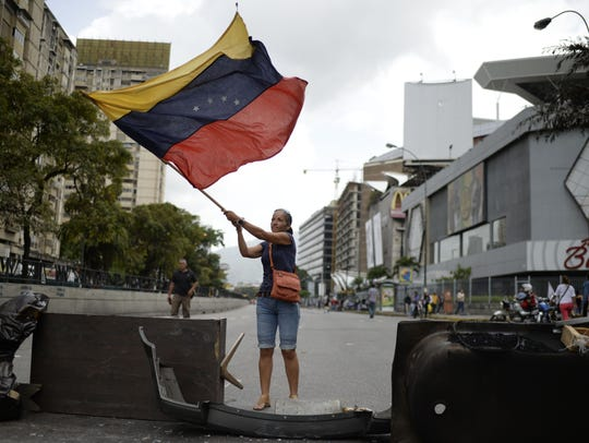 Venezuelan opposition activists protest in Caracas