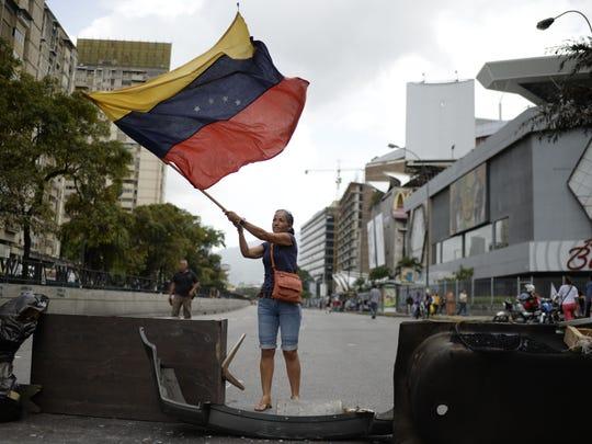 Venezuelan opposition activists protest in Caracas on July 10, 2017.