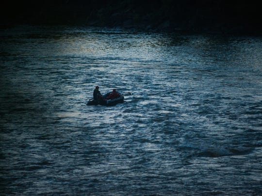 Search and rescue personnel work in a raft on the Winooski River just below the hydroelectric facility in Winooski late Tuesday, July 11, 2017, during a search for an 11-year-old believed to have fallen into the water.