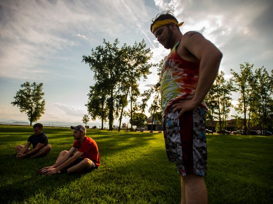 Travis Miller at the Pride Center of Vermont stretches with a running group he organized that meets every two weeks.