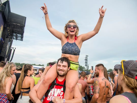 Festival goers attend the Faster Horses Music Festival