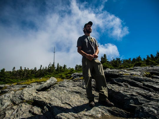 Adam Joseph, Mansfield lead with the Green Mountain Club, keeps a watchful eye out for hikers along the alpine zone of Vermont's highest peak. His mission: keep people on the rocks, off rare plants and, most importantly, off the soil deposits that, if eroded away, would remove the very thing those rare plants need to survive. A majority of the species growing on the mountain are rare to say the least, some only found there.