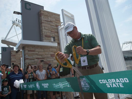 CSU Athletic Director Joe Parker cuts a ribbon during an open house for CSU's new on-campus football stadium on Saturday, August 5, 2017. More than 10,000 Rams fans got their first look at the facility with a concessions and amenities in operation.
