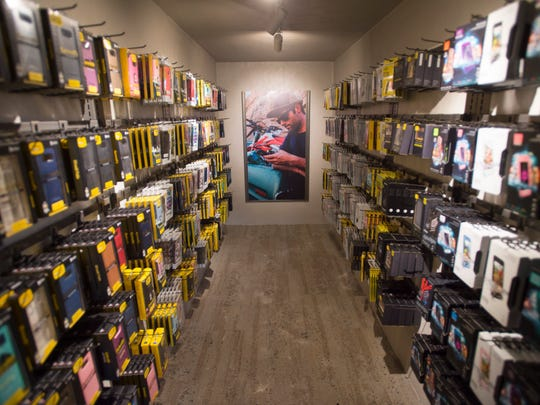 OtterBox and LifeProof phone cases line the walls of the Otter Shop during its grand opening in 2017. The Fort Collins store on Mountain Avenue is the only OtterShop in the country.