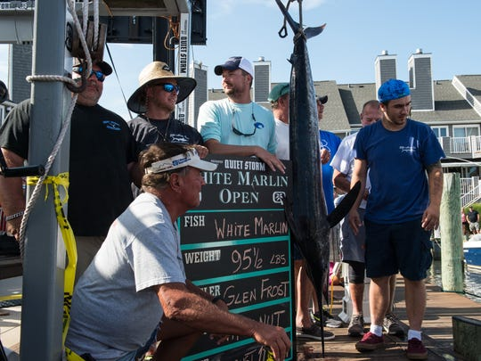 The crew of the Wire Nut poses for a photo with their 95.5 pound marlin during the White Marlin Open at Harbour Island Marina in Ocean City on Friday, Aug. 11, 2017.