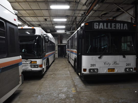 A group of City of Poughkeepsie buses sitting at the City of Poughkeepsie Central Garage Facility.