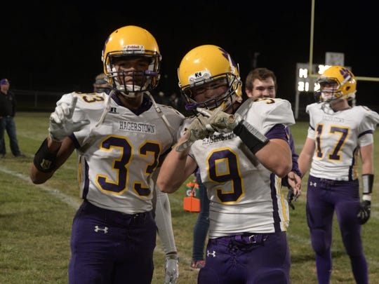 Jalen Oliver (33), and Mason Hicks (9) during Hagerstown's football game at Winchester Friday, Sept. 1, 2017.