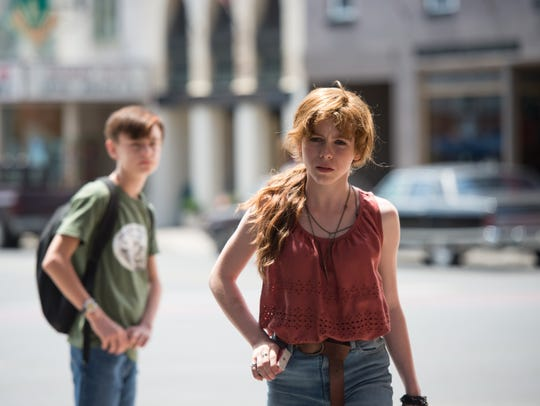 "Jaeden Lieberher and Sophia Lillis star in ""It."""