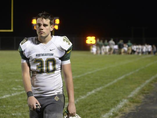 Northeastern's Hunter Kirkland (30) walks off the field