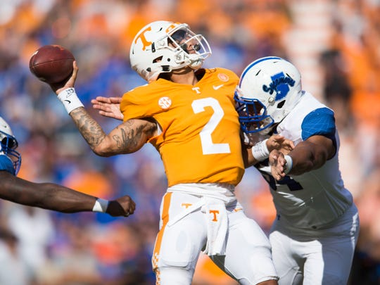 Indiana State defensive tackle Adrian Butler (54) attempts to take down Tennessee quarterback Jarrett Guarantano (2) during the Tennessee Volunteers vs. Indiana State Sycamores game at Neyland Stadium in Knoxville, Tenn. Saturday, Sept. 9, 2017.