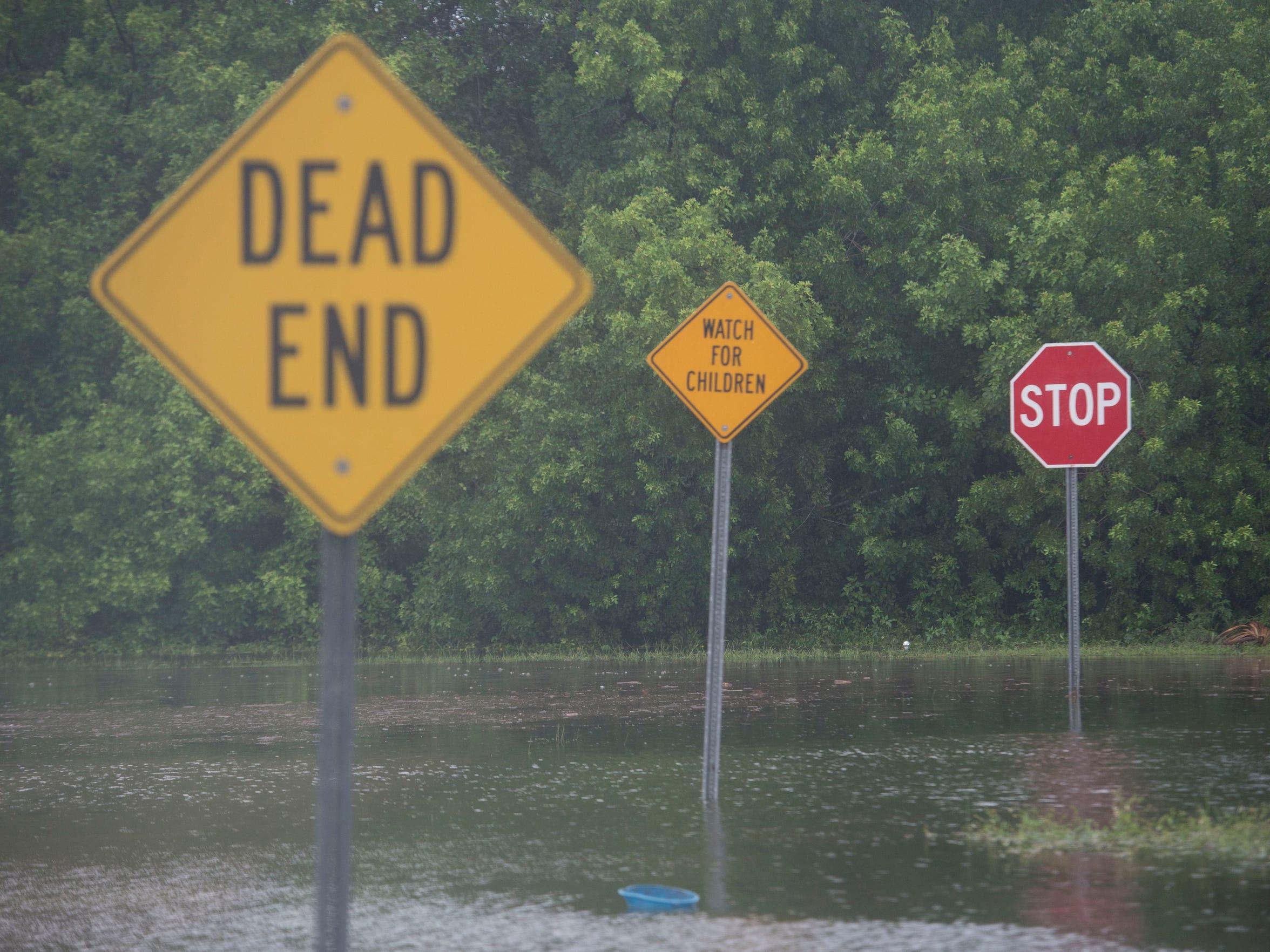 Roads are flooded near Sunrise Boulevard and Maravilla Boulevard on Sunday morning in Fort Pierce.