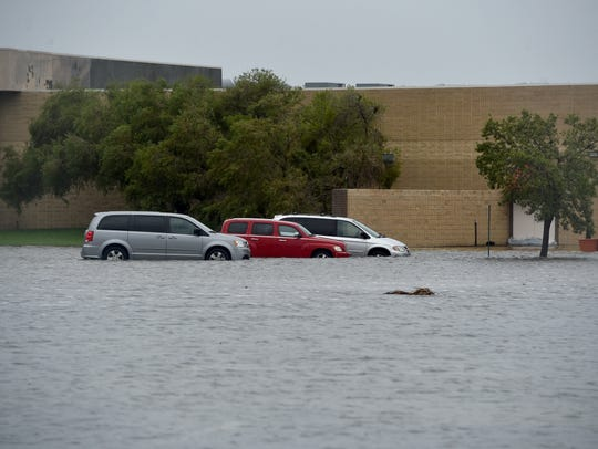 Stranded cars are seen as heavy rain from Hurricane