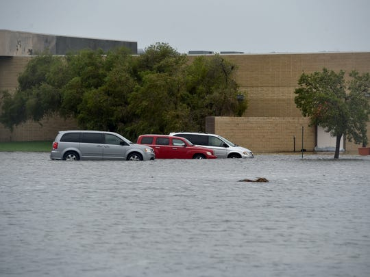 Stranded cars are seen as heavy rain from Hurricane Irma floods the parking lot of the Orange Blossom Budiness Center on Okeechobee Road on Sunday, Sept. 10, 2017 in Fort Pierce.