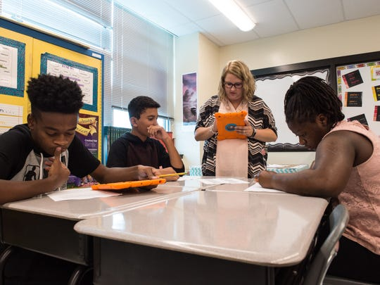 Wicomico Middle School teacher Erika Taylor helps students