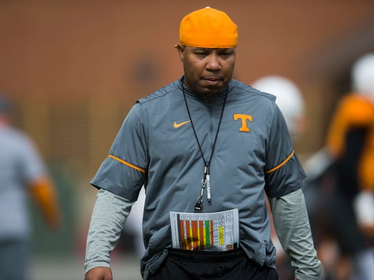Running backs coach Robert Gillespie walks on the field during University of Tennessee fall football practice at Anderson Training Facility in Knoxville, Tenn. on Tuesday, Sept. 12, 2017.