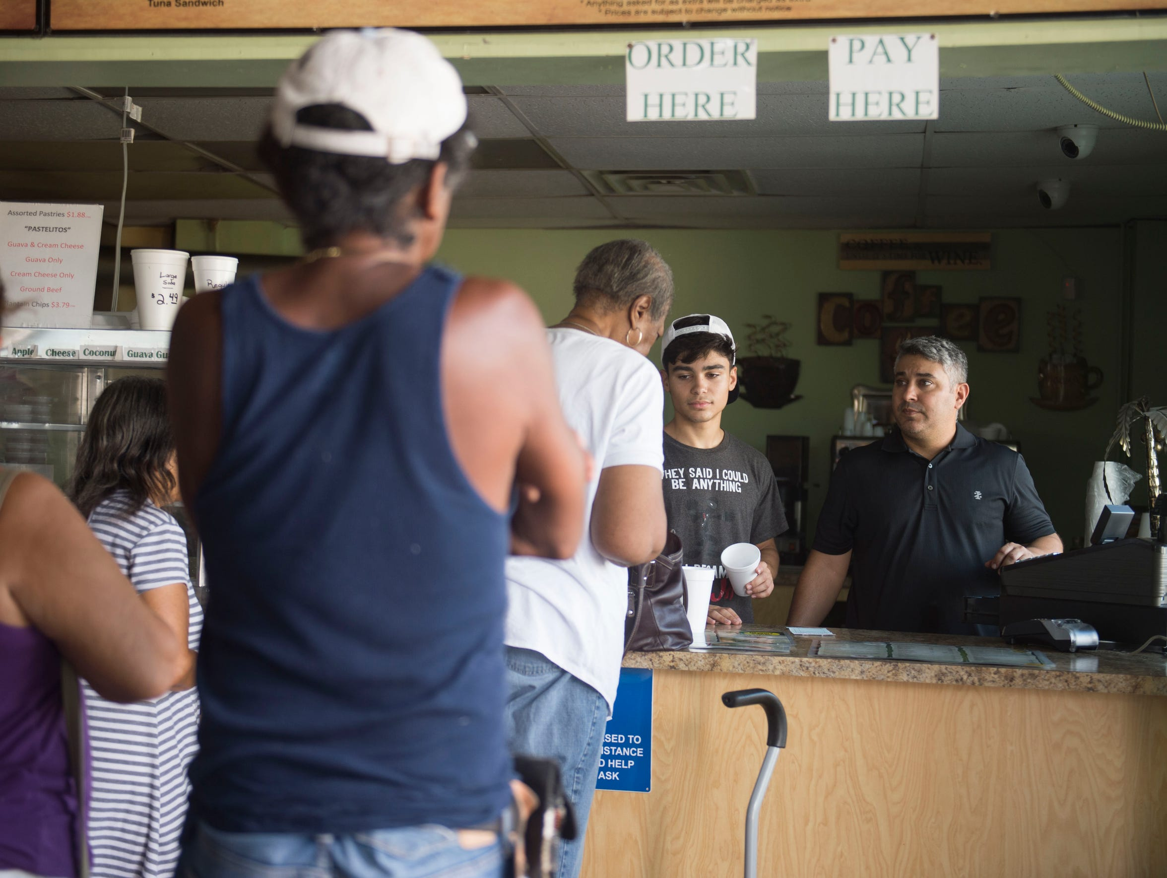 Mervis' Cafe owner Ivel Sierra (right) and son Ethan