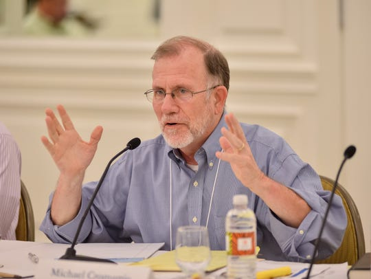 Michael Cromartie, who guided journalists on religion,