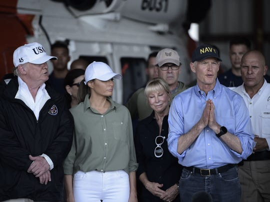 US President Donald Trump (L), First Lady Melania Trump (2nd L) listen to Florida Governor Rick Scott as he speaks during a briefing on Hurricane Irma relief efforts at Southwest Florida International Airport in Fort Myers in 2017.