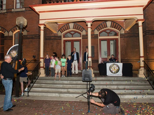 Wicomico County Executive Bob Culver turns on newly installed lights at the courthouse during Wicomico County's 150th anniversary celebration on Friday, Sept. 15, 2017.