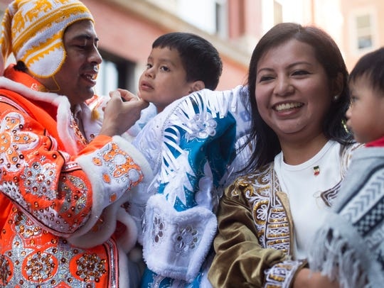 Carlos Pinilla and his wife, Anabel Lino, with their children Valentino, left, and Maximo are dressed in traditional Bolivian clothing for the HoLa Festival Parade of Nations on Sept. 17, 2017. The 2018 festival will be held Sept. 29-30.