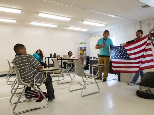 Students and teacher Matthew Miller await the Pledge of Allegiance at Choices Academy on Tuesday, Sept. 19, 2017.