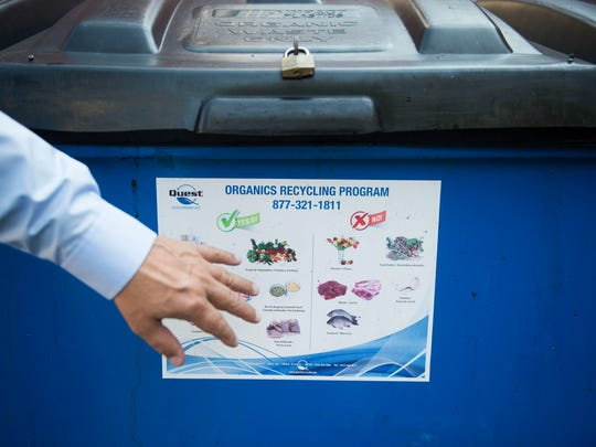 Kroger assistant manager Lynn Cox shows the bin that compostable materials are placed in at the Farragut Kroger Marketplace in West Knoxville Thursday, Sept. 22, 2017.