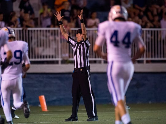 A referee signals a Reitz touchdown during the game between the Memorial Tigers and the Reitz Panthers at the Reitz Bowl in Evansville, Ind., on Saturday, Sept. 23, 2017. Memorial won 41-21.