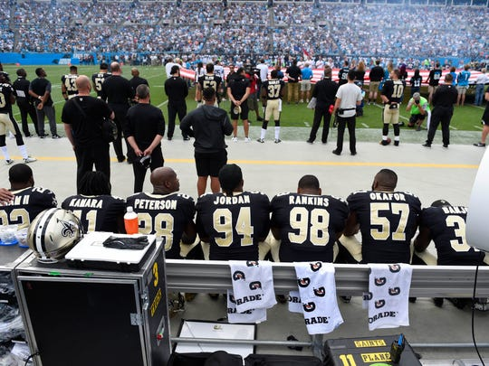 Sep 24, 2017; Charlotte, NC, USA; New Orleans Saints players sit during the national anthem at Bank of America Stadium. Mandatory Credit: Bob Donnan-USA TODAY Sports