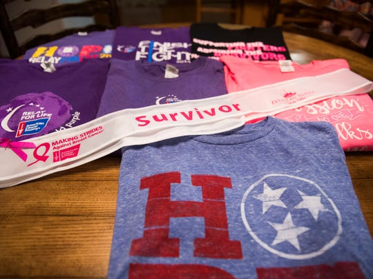 A breast cancer survivor sash and souvenir shirts from cancer awareness/fundraising events sit on a table in the home Debbie Pearsall and her mother, Martha Wilson, share in McMinnville on Sept. 19, 2017. Both women are breast cancer survivors.