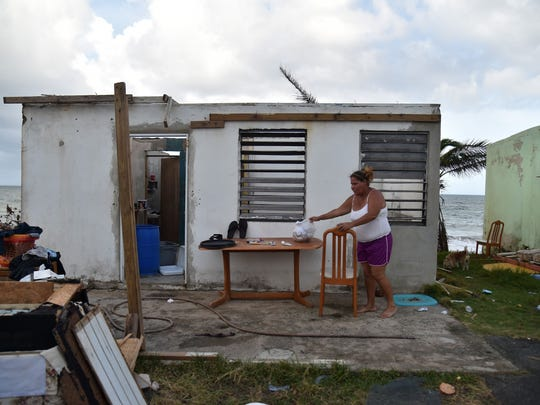 Yasmin Morales is pictured on September 28, 2017 in her damaged house in Yabucoa, in the eastern part of storm-battered Puerto Rico, following a week of devastation by Hurricane Maria. One week after the Category Four storm stuck, the White House said US President Donald Trump had made it easier for fuel and water supplies to arrive to the ravaged island of 3.4 million US citizens. / AFP PHOTO / HECTOR RETAMALHECTOR RETAMAL/AFP/Getty Images