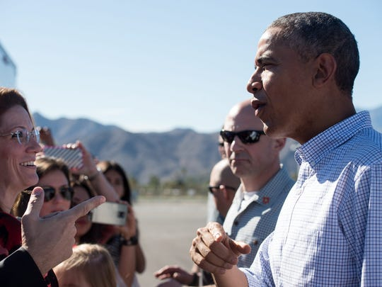 President Barack Obama greets wellwishers on February 14, 2015 as he arrives in Palm Springs, California where he will spend the Presidents Day weekend.