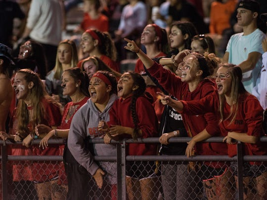James M. Bennett fans cheer for their team during a