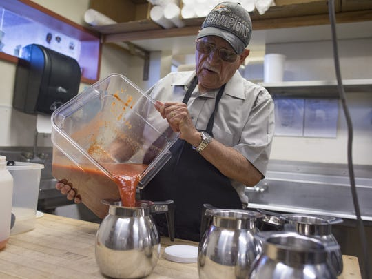 Frank Perez fills pitchers with salsa at Pobre Pancho's on Friday, October 6, 2017. Perez, who opened the restaurant in 1969, still comes in to work every day to help with prep work in the kitchen.