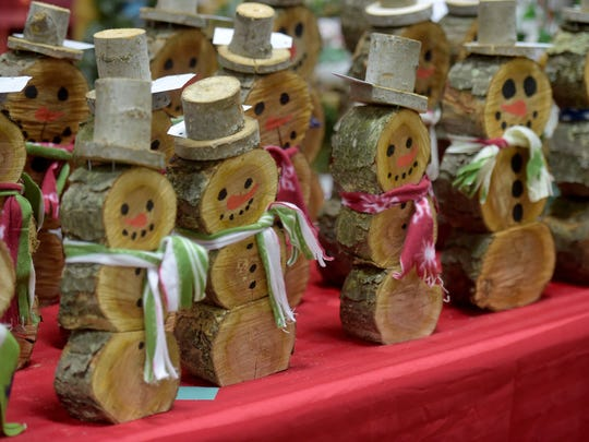 People looking to get in the holiday spirit attend area craft markets and holiday bazaars.