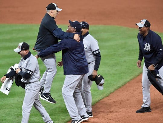 New York Yankees manager Joe Girardi (28) jumps in