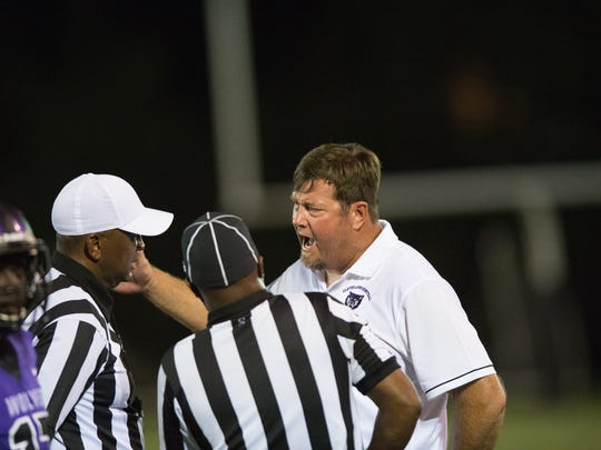 Cleveland Central coach Ricky Smither argues with referees during a Sept. 22 game against Callaway. Cleveland Central won 27-20, and the Wolves are now 9-0 in their first season.
