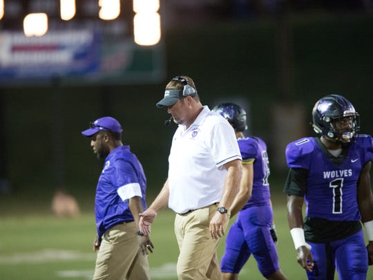 Cleveland Central coach Ricky Smither walks back to the sideline during a Sept. 22 game against Callaway. Cleveland Central won 27-20, and the Wolves are now 9-0 in their first season.