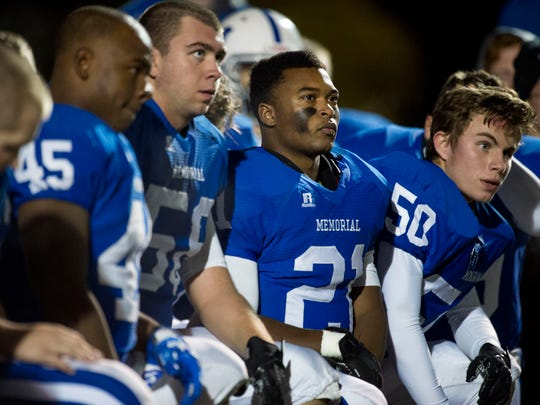 Memorial's Kenyon Ervin (21) listens to Memorial Head Coach John Hurley after their 49-15 win over Washington at Romain Stadium in Evansville, Ind., on Friday, Oct. 27, 2017.
