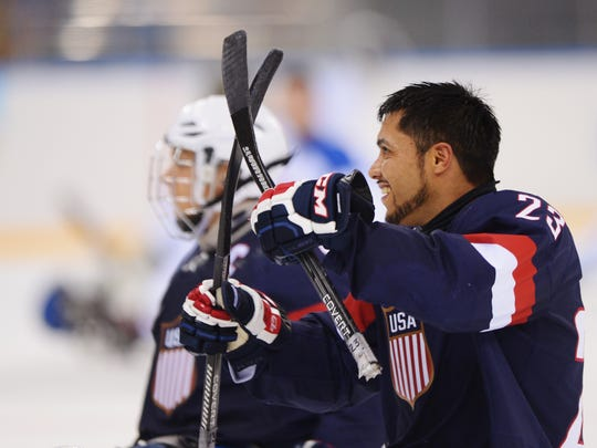 Rico Roman of the United States celebrates after the