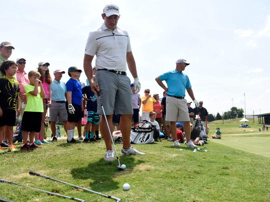 Golf pros Scott Stallings, left, and Josh Broadaway give demonstrations and answer questions at the Food City Kid's Clinic at Fairways and Greens on Aug. 16, 2015.