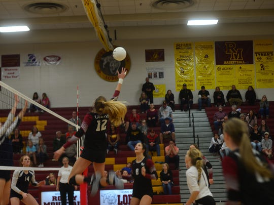 Rocky Mountain's AnnMarie Dodson stretches for a spike during Saturday's regional match against Ralston Valley.