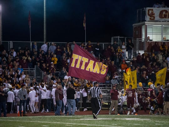Titans students wave a flag as the Gibson Southern