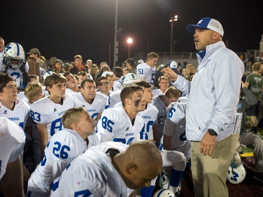 Memorial Head Coach John Hurley speaks to his team after their 26-17 win to claim the Class 3A Sectional 32 championship title at Gibson Southern High School in Fort Branch, Ind., on Friday, Nov. 3, 2017.