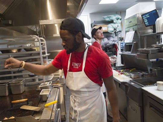 Xavier Coleman works on the grill during the lunch rush at Comet Chicken on Wednesday, November 1, 2017. The fried chicken joint, located on Mountain Avenue in Old Town is the latest creation from Hot Corner Concepts.