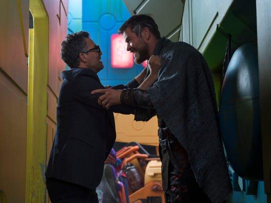 Mark Ruffalo (left) and Chris Hemsworth in a scene