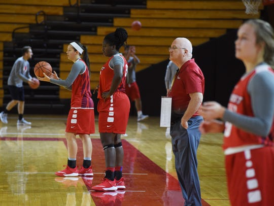 Brian Giorgis, center, head coach for Marist's women's basketball team, watches the team practice on Tuesday.