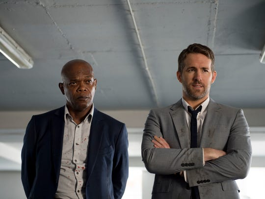 Samuel L. Jackson, left, and Ryan Reynolds star in